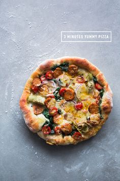 3 minutes cast iron skillet pizza: Italian Sausage, Spinach, Artichokes Hearts, Tomatoes and Mozzarella Cheese
