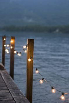 Nicole asks Gabby to take pictures of her and Ryan on the town dock. Fairy lights led them to the end where there was a beautiful black arch covered in ivory and more fairy lights created. Haus Am See, Lake Cottage, Coastal Cottage, Lake Life, Belle Photo, String Lights, Dock Lights, Festoon Lights, Twinkle Lights
