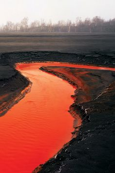 the brilliant vermilion river above, tainted by toxic tailings from a nearby nickel mine in Canada. The photograph, taken by Edward Burtynsky in depicts an eerie and forbidding landscape. Mother Earth, Mother Nature, Red River, Dere, Science Nature, Landscape Photography, The Good Place, Cool Things To Buy, Beautiful Places