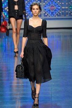 Dolce & Gabbana - Love the neckline of this LBD. The net socks are cute.