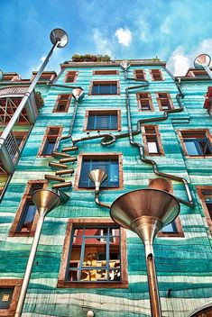 The Neustadt Kunsthofpassage is an artistic neighborhood in Dresden, Germany. Designed by artists Annette Paul, Christoph Roßner and André Tempel, this wall, covered with funnels and gutters, literally plays music when it rains.