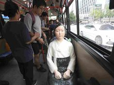 Statues symbolizing the World War II sex slaves abused by Japanese soldiers have appeared this year on Korean city buses — including on a bus line whose doors open right in front of Japan's embassy. Political Art, Yesterday And Today, World War Ii, We The People, Female Art, Buses, Korean, Statues, Japanese