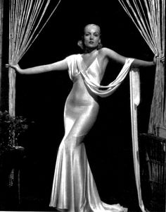 A dress that has apparently been poured onto Carole Lombard