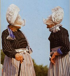 Costume of Volendam, North Holland, The Netherlands- these lace headpieces are called Kraplaps.