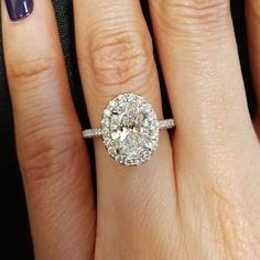White gold oval halo engagement ring: Elegant oval-shaped halo engagement rings have been getting a lot of attention on Instagram, and we know that a lot of you are dreaming of one of your own.   Halo Engagement Rings for a Sparkling New Year