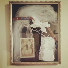 Wedding shadow box. Includes dress hanger, garter, vail, engagment announcment from paper, wedding program, and wedding bubbles! Photo by sdecoste5