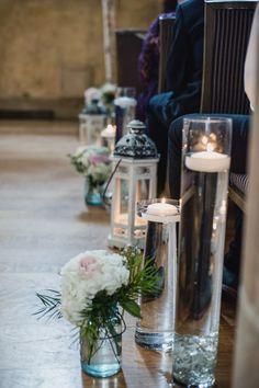 Elegant wedding aisle marker idea - floating candles in hurricane vases, lanterns, and floral arrangements {Kari Dawson Weddings}