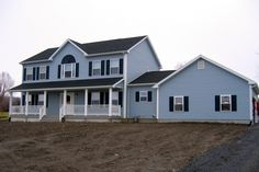 homes | Classy two-story home in blue with extension and garage. The full walk ...