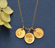 Two Personalized Hand stamped 24 K Vermeil Gold Disk Charms Family tree Necklace - Custom handstamped charm pendant - mother, grandmother. $34.99, via Etsy.