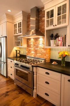 green beadboard backsplash, brick behind range