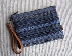 Handmade pouch in Grunge Rock stonewashed denim style. Absolutely unique item. Recycled denim.