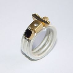 Silver ring set with diamond & 18ct gold by Paul Finch