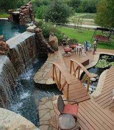 This is asolute perfection for my dreams! Pool waterfall, bridge and koi pond! Ive always wanted a koi pond and pool! Outdoor Spaces, Outdoor Living, Outdoor Pool, Outdoor Office, Outdoor Fountains, Water Fountains, Garden Fountains, Dream Pools, Cool Pools