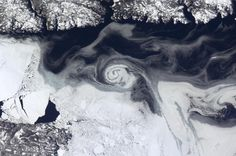A gyre frozen into the ice, in Newfoundland, Canada is pictured in this handout photo courtesy of Col. Chris Hadfield of the Canadian Space Agency, from the International Space Station, taken on March 22, 2013.