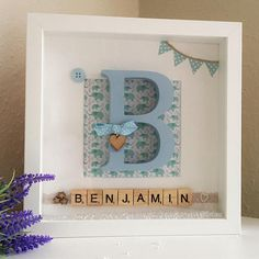 New Baby Gift, New Baby, Gift for Baby Boy, New Baby Frame, Baby boy, Custom name frame, Baby shower gift This lovely baby boy welcome frame makes a fantastic personalised and unique gift for any new parents. Fully customisable - just send us a convo on checkout with the special little boys Initial, name (and birth details if a heart tag is required). Soft blue hues are used to create this frame which makes it perfect for hanging in babies new nursery. A large wooden letter is added to th...