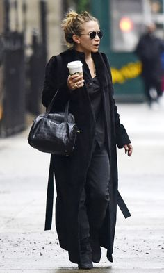 Mary-Kate Olsen // messy bun, aviator sunglasses, long maxi coat, button-down shirt, croc bag, skinny jeans and boots #style #fashion #theolsentwins