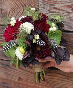 Deep red, white succulent and feather bouquet