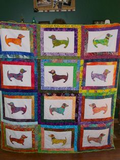 Dachshund quilt done in batiks - 2013 Pattern can be found here http://www.lavender-rabbit.com/servlet/the-356/Hot-diggity-dog,-dachshund,/Detail