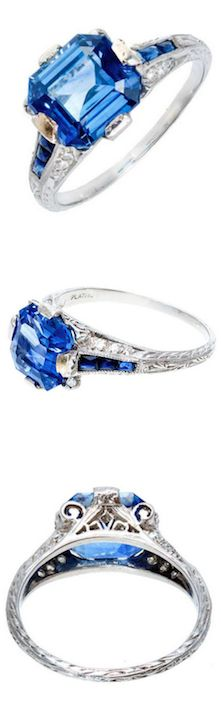*Art Deco Emerald Cut Sapphire Diamond Ring, This ring screams Art Deco Style loud and clear. Authentic roaring 20's deco styling. Beautiful pierced filigree work and engraved Platinum ring with Edwrdian style and flare. Set with 16 single cut diamonds and 6 calibre cut genuine blue sapphires. The center is set with an original Asscher step cut 8 sided well-polished genuine blue sapphire.