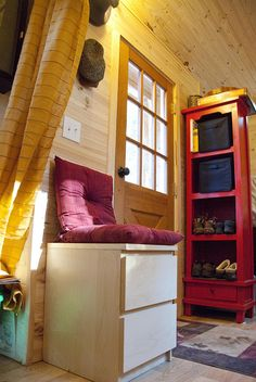 """suko & jerry, stwerads of sarana park, live in two """"tiny houses"""" (one for sleeping, one for entertaining/cooking) connected by a covered portico."""
