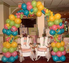 Unique baby shower balloon arch.