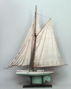 American large wood model of sail boat with green base and green & white hull (19/20th Cent)