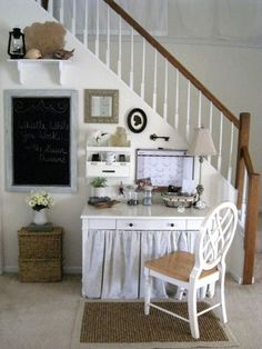 Tiny area under stairs this homeowner set up as her office. Cute!