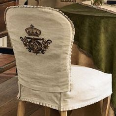 I like how there is a design on the back of the chair - reminds me of a family crest or something.
