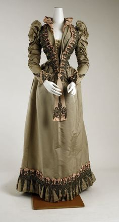 An immensely beautiful, puff sleeved, elegantly tailored ensemble dating from 1887-91