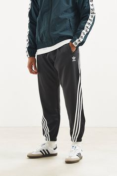 adidas - Wrap Track Pant - $80.00 Mens Joggers Sweatpants, Famous Brands, Athletic Wear, Stylish Men, Urban Outfitters, Thighs, Fitness Models, Sportswear, Adidas