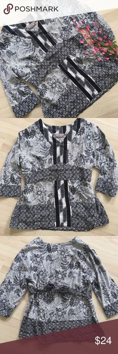Mixed media black and white floral striped blouse Gorgeous black and white patterned top! It has a tie that cinches the waist and is super flattering. In perfect condition with no signs of wear. life style  Tops Blouses