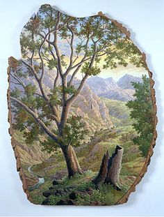 Beautiful art work on a slice of a log.