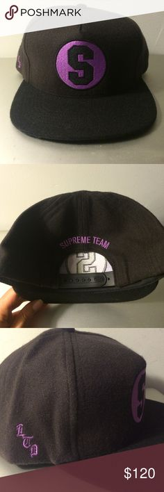 """Supreme Snapback This Supreme hat is made of soft merino wool. It has never Ever been worn or tried on. Brand New vintage collectors supreme piece. Not sure what year this was released, will update. Colors: A very deep chocolate cap ( almost black)  with a complimenting black brim, featuring a dark Lavender """"S"""" logo on the front and  """"Supreme Team"""" on the back. Purchased at Supreme Nyc Supreme Accessories Hats"""