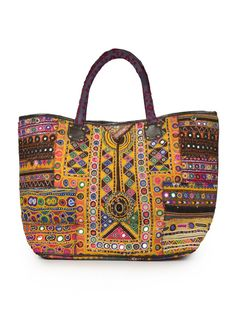 I am off to India this summer and I am imagining wandering through the markets with this bag- believe me, it will blend right in with all the vivid colors!   Tribal Tote from Rainbow Run @Jaypore