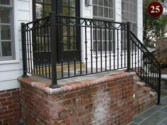 Stairs down both sides with concrete slab patio with brick border. Outside Stair Railing, Wrought Iron Porch Railings, Exterior Stair Railing, Cast Iron Railings, Patio Railing, Outdoor Stairs, Aluminum Railings, Patio Steps, Brick Steps