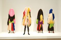 """Artist Nick Cave creates sculptural works that he calls """"Soundsuits"""" consisting of brightly colored fabrics, elaborate embroidery, beadwork, raffia, and, other natural materials. Phyllis Galembo's photographic portraits feature masqueraders from the West African countries of Benin, Nigeria, and Burkina Faso."""