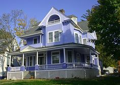 an impressive Victorian house down the street from the New Britain Museum of American Art, which was featured two days ago.  It is painted periwinkle blue. #bluepaint #trees #victorianhouse