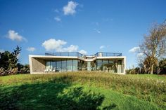 The living and dining areas and kitchen in UNStudio's Dutch house all face a polder landscape of reclaimed wetlands