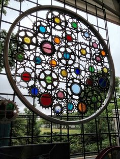 Stained glass bicycle wheel----make one as trellis by alyssa Stained Glass Designs, Stained Glass Projects, Stained Glass Art, Stained Glass Windows, Mosaic Art, Mosaic Glass, Fused Glass, Bicycle Art, Bicycle Wheel