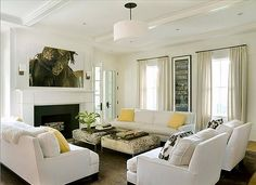 eric+roth+photography+photographer+winter+white+living+room+yellow+accent+throw+pillows+wild+horses+of+sable+island+photograph+drum+pendant+light