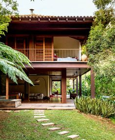 Open plan, the external just gets inside - the plinth is also almost missing to assert a separate territory - aids more intergration of outside and inside. Upper open verandahs and sloping roof wood and tiles - got to be tropical! [บ้านไม้สองชั้น]