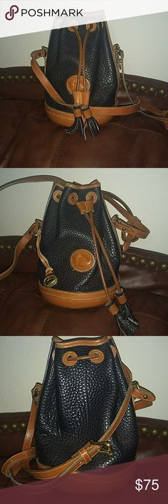 Vintage Dooney & Bourke small saddle bag FOR YOU VINTAGE DOONEY LOVERS!! This one is circa 1995..Navy blue, all leather, small saddle bag style purse!  Used condition, still beautiful!! Dooney & Bourke Bags Satchels