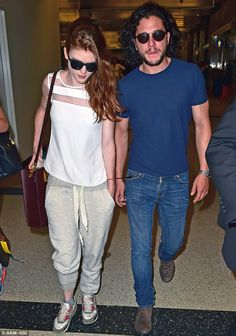 Is love back in the air?: Kit Harington walked closely with ex-girlfriend Rose Leslie as the Game of Thrones stars made their way through LAX airport http://dailym.ai/1nY3201