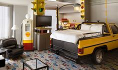 The Trucker Room at Fantasyland Hotel in West Edmonton Mall, complete with a truck bed, street lights, gas pump and traffic carpets. Themed Hotel Rooms, Theme Hotel, Truck Room, Truck Bed Storage, Unusual Hotels, Hotels For Kids, Hotel Suites, Room Themes, Kids Bedroom