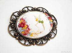 White brooch of miniature Tinkerbell by DZHandmadeProducts on Etsy, $40.00