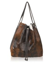 bc91e4db3955 The iconic Owen Barry backpack that converts from a stunning drawstring  shoulder bag. Suede -