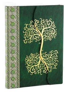 The Celtic Tree Journal is a wonderful blank book, perfect for use as a sketchbook, Book of Shadows, or diary. The hardbound cover folds over itself in front, sealing closed magnetically across the seam.  Measures 7-1/4