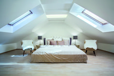 Bright loft conversion creating a double bedroom in roof space.