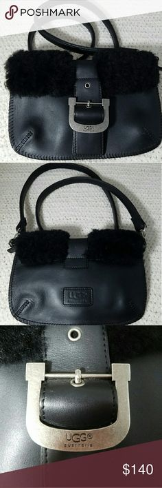 """UGG Black Leather Crossbody Bag with Sherpa Fur Brand: Ugg  Item: *Black Leather Cross Body *Snaps Closed *Also a Zipper to Close top of Purse *Back Has Ugg Patch *Fur on Top of Crossbody on Both Sides of the Buckle, Front & Back *Interior Has One Imterior Comparrmemt *Strap is 42.5 *Silver Hardware *Strap can Removes to Use as a Clutch *Has 3 Very Light Marks on Front of Bag & A Bit Of Purse Debris - the fuzz that always winds up in the bottom (Otherwise Excellent Condition *Measures 8""""w x…"""