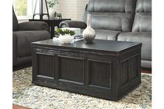 """With a lift tabletop on one side and trunk storage on the other, the Gavelston lift-top coffee table has raised our expectations. While it sure looks like a fabulous flea market find, it's """"weathered"""" only in appearance, care of a dry vintage finish with rubbed-through distressed marks."""